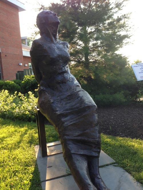 woman library sculpture