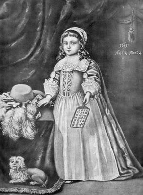 child holding hornbook